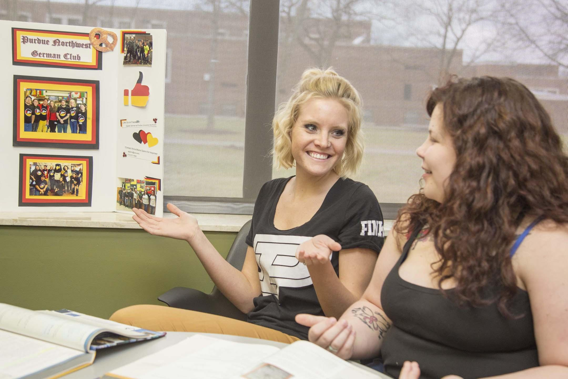 Anna Gianni (left) and Bonnie Hamstra, junior elementary education major (right), talk about German club together.