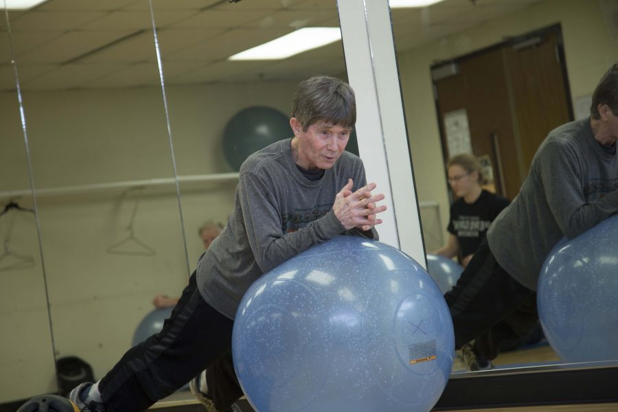 John+Bobalik%2C+PNW+fitness+director%2C+leads+abs+and+core+exercise+class.+