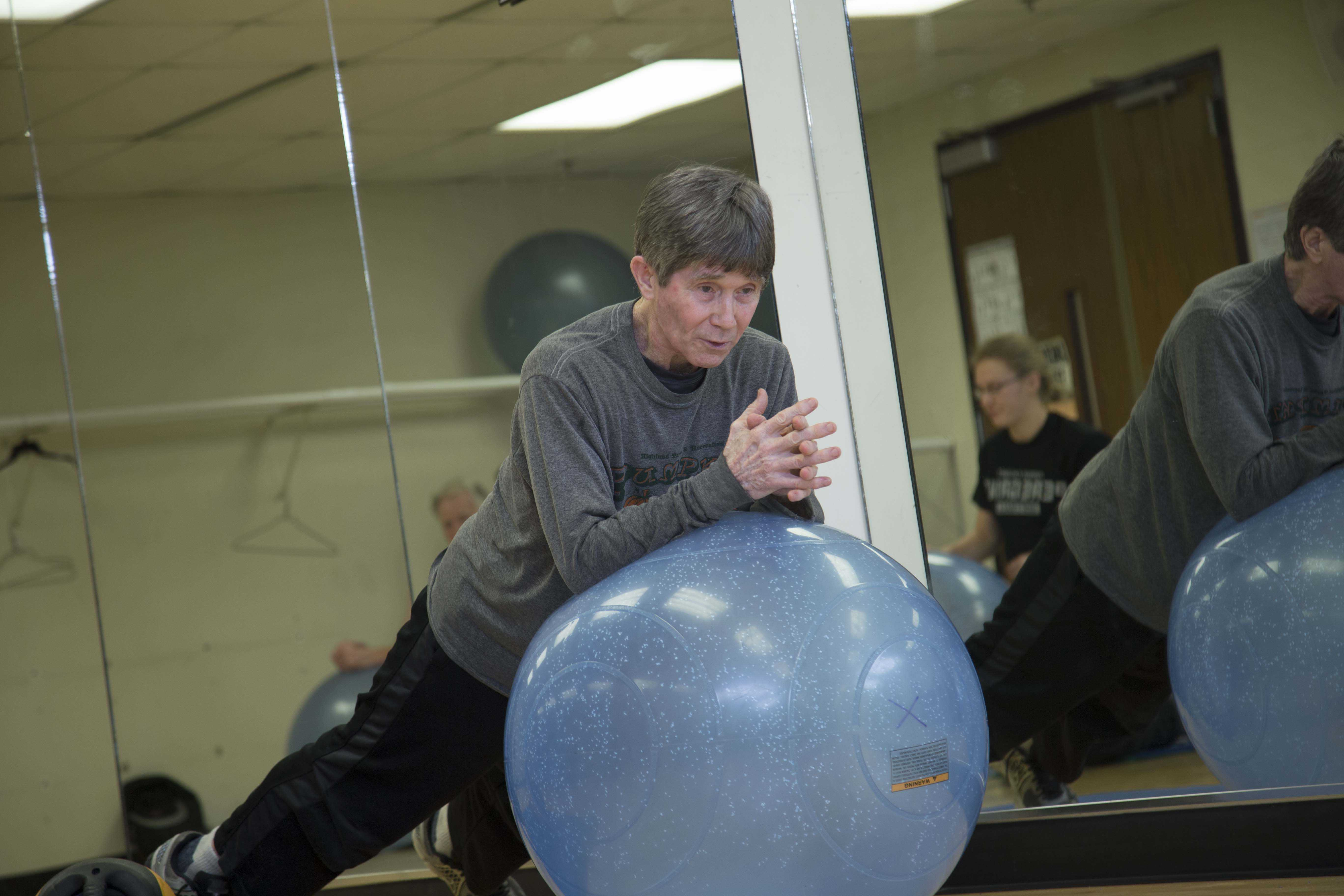 John Bobalik, PNW fitness director, leads abs and core exercise class.