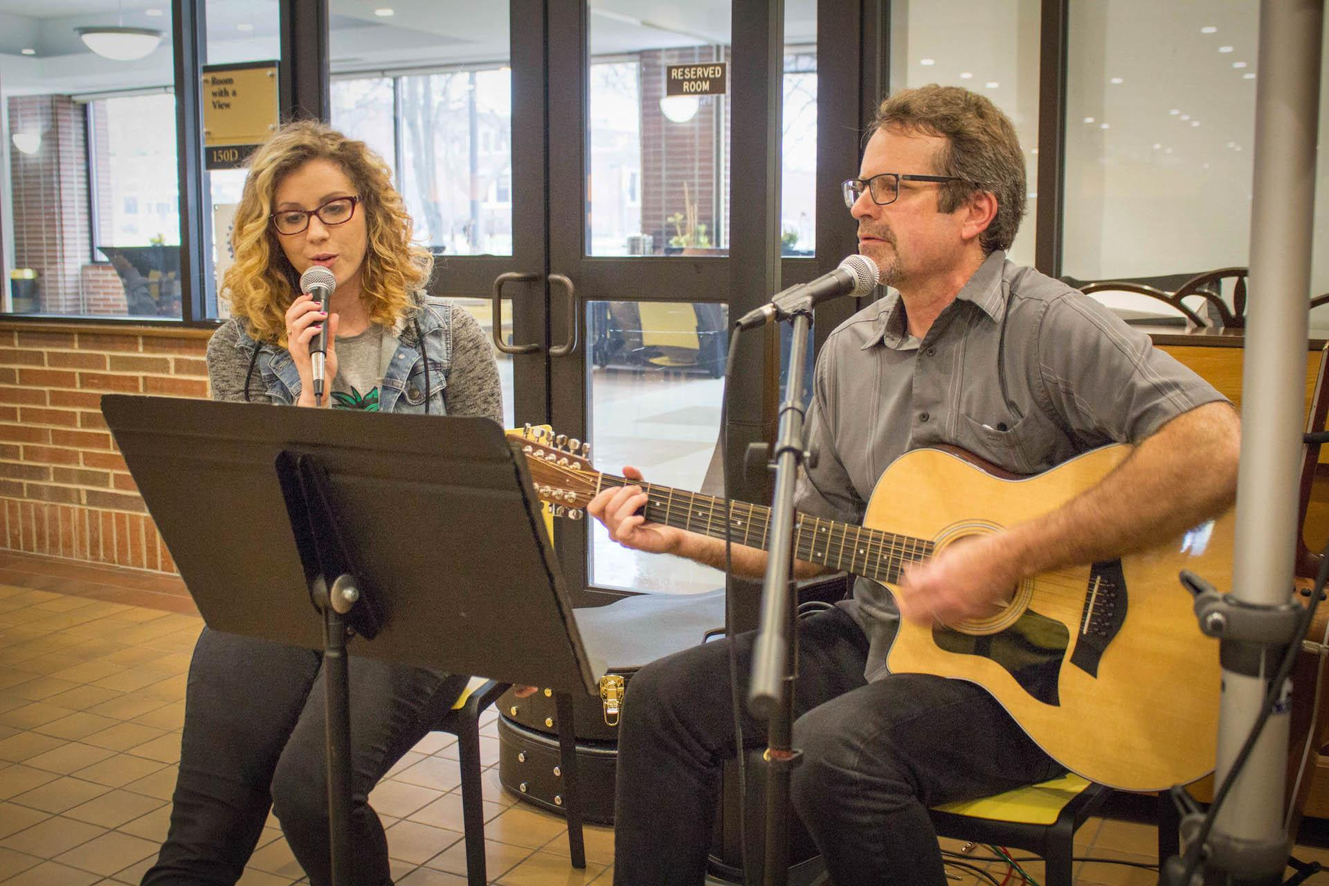 Ashley Peterson (left) and TJ Holsen (right) sing acoustic renditions of classic rock and pop songs on Feb. 22.
