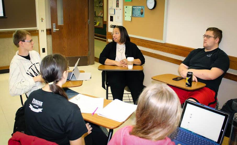 Karen Bishop-Morris, center, hosts a group discussion with students.