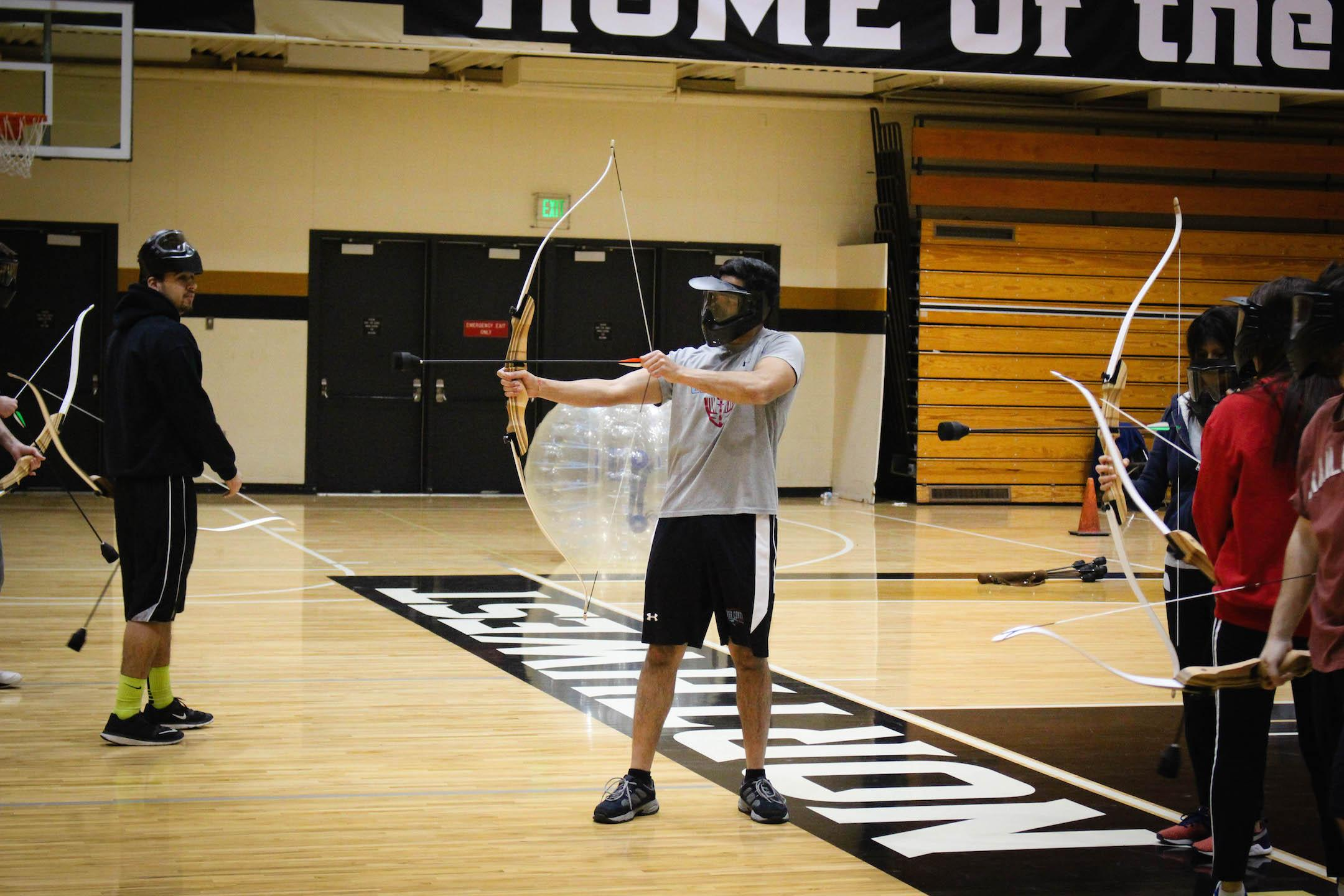 Syed Zeidi, sophomore electrical engineering major, draws his bow during combat archery.