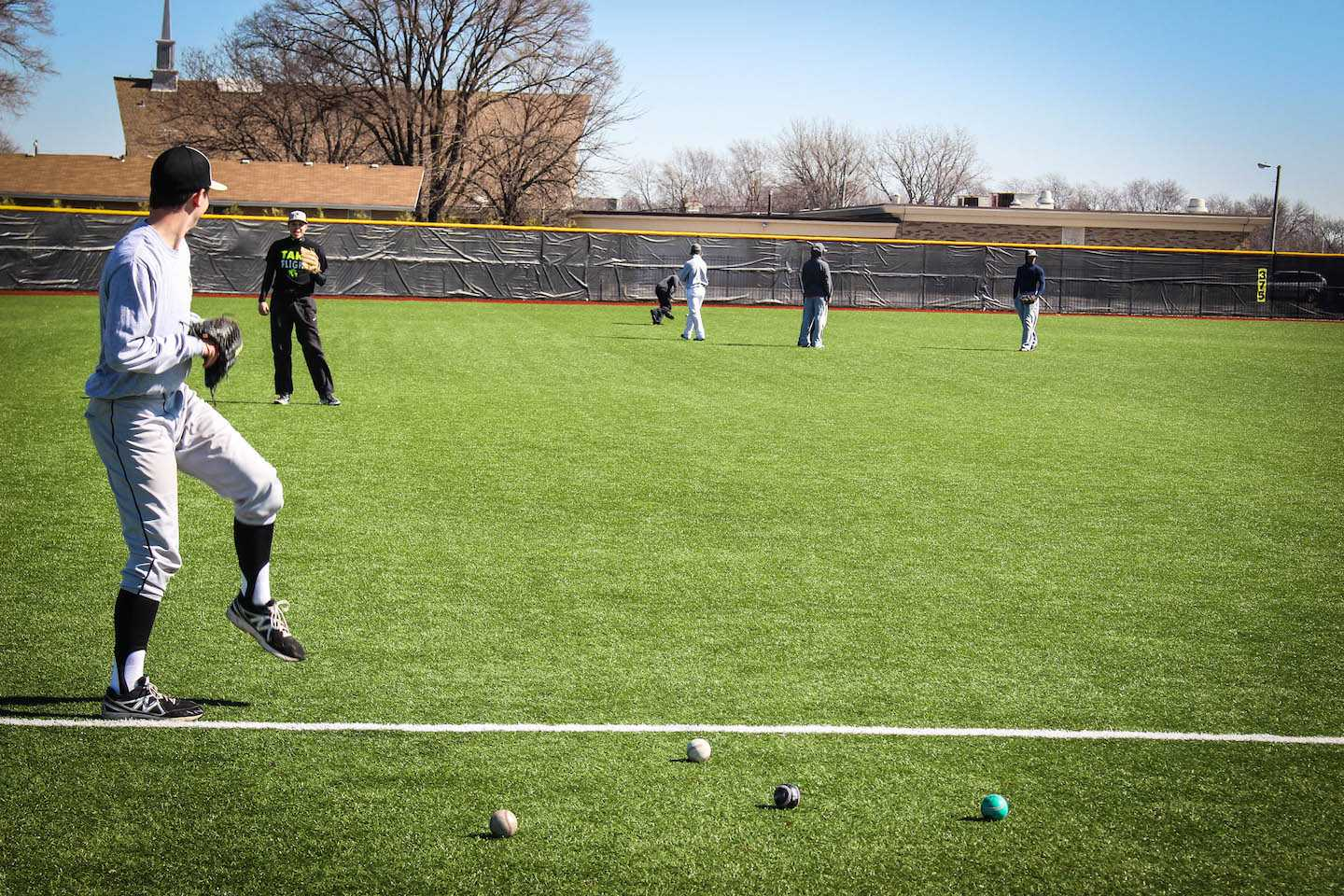 Baseball players warm up during practice.