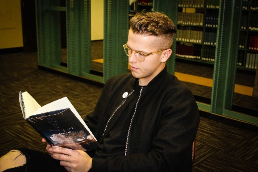 Matt Scheffer, junior business management major, spends his off hour catching up on reading in the library.