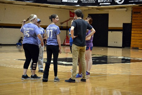 Greek organizatoin members huddle up before a volleyball match on March 29 in the FRC at the Hammond campus.