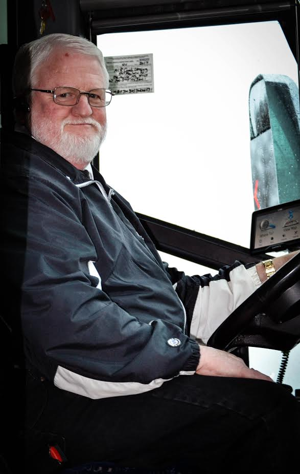 Dennis Seals, ACR coach driver, sits in his bus, waiting for students to take them to the Westville campus