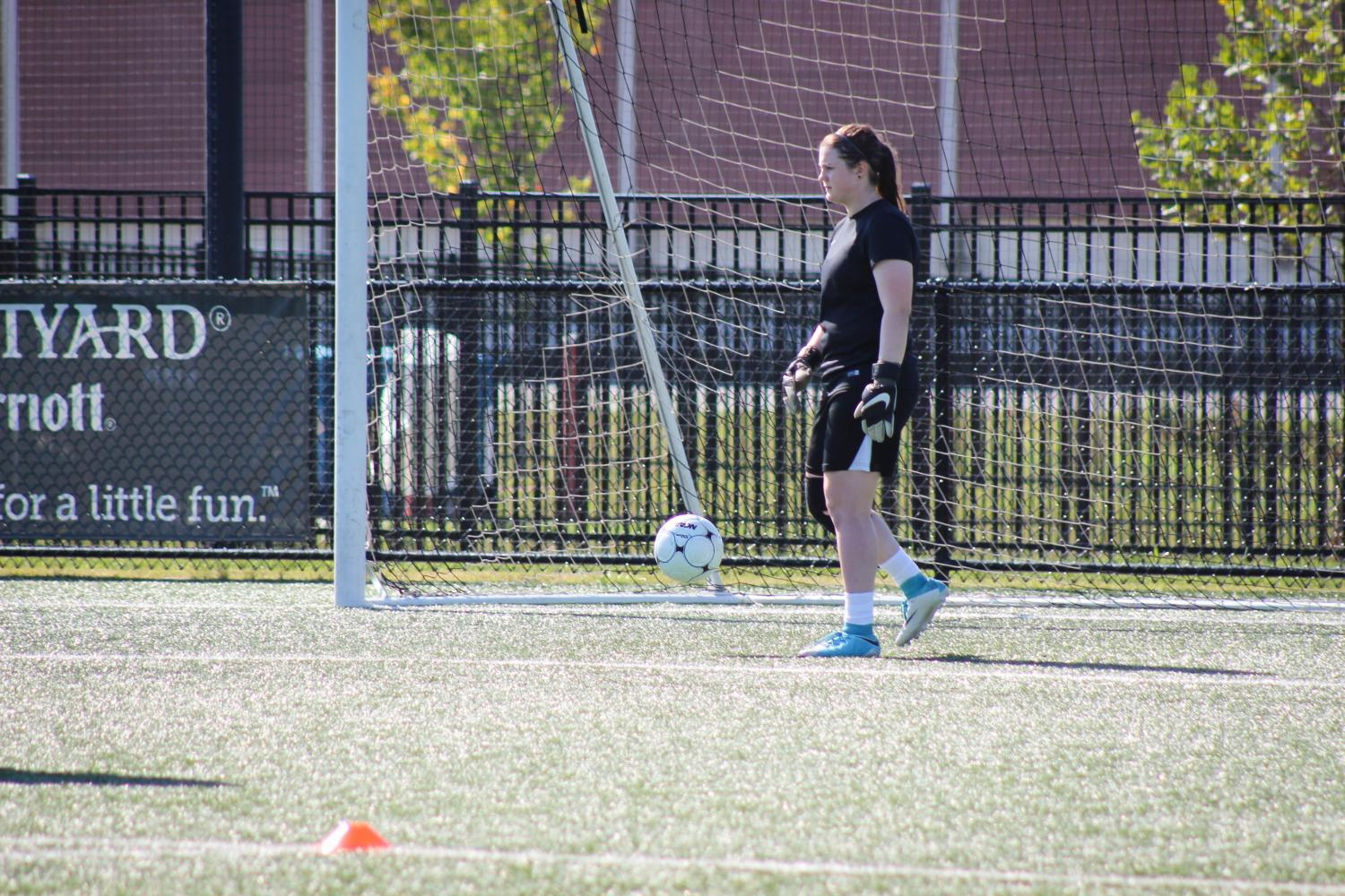Lucie+Ashmore%2C+senior+co-captain+of+the+team%2C+practices+as+goalkeeper+before+the+season+starts.