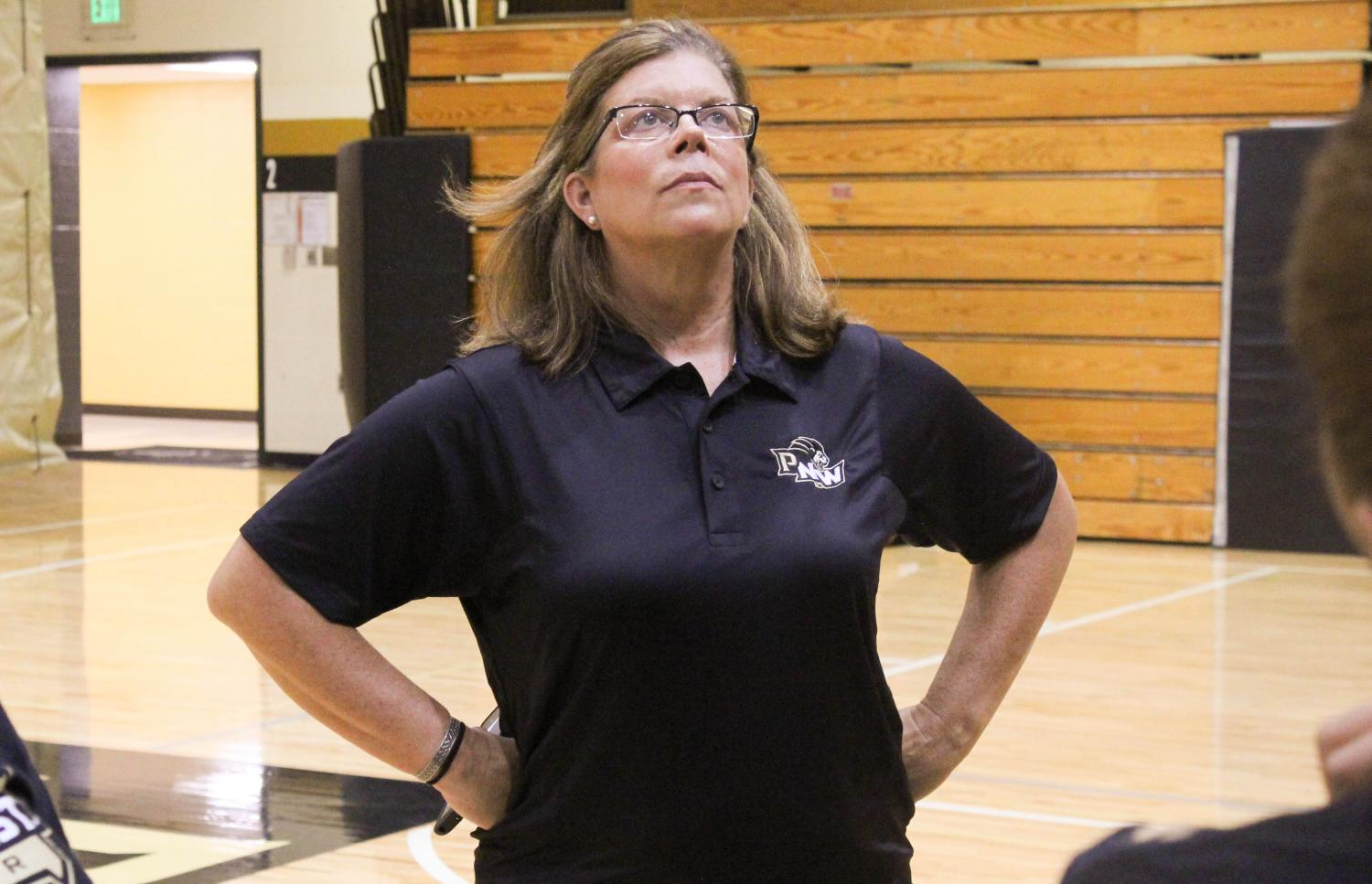 Michelle Searer, cheer coach, watches her team practice for the upcoming season.