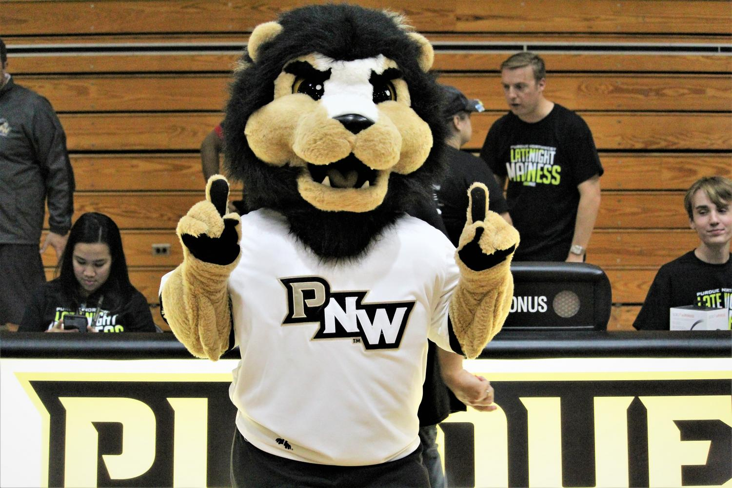 PNW's mascot, Leo the Lion, cheers on the basketball team at Late Night Madness