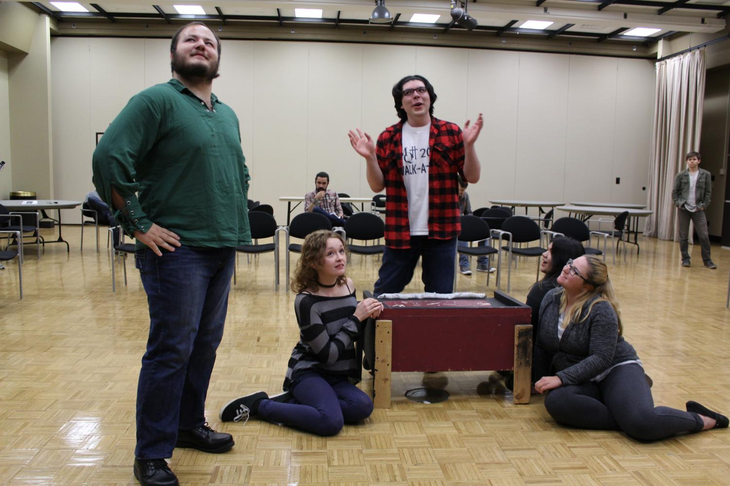 Sheriff Nottingham, played by James Solis (left), plots with the Evil Prince John, played by Matthew Ruiz (center) to take down Robin Hood, with the fawning ladies' support, played by Sam Garcia (left), Natalie Villarruel (back right) and Bailey Kien (front right).