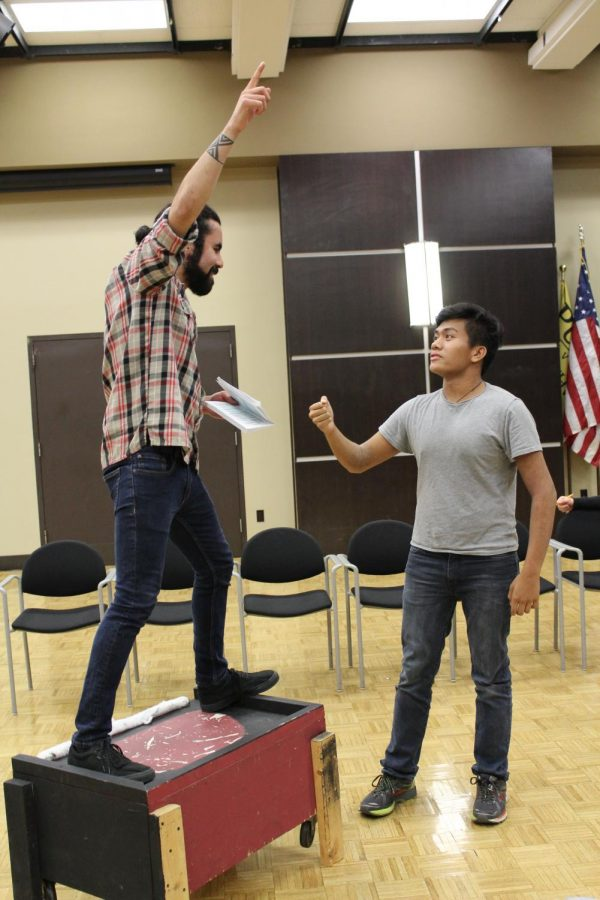 Robin Hood, played by Cristian Galvan (left), speaks to one of his Merry Men, played by Niko Cabela (right), about the upcoming archery competition to win the favor of Lady Marian.