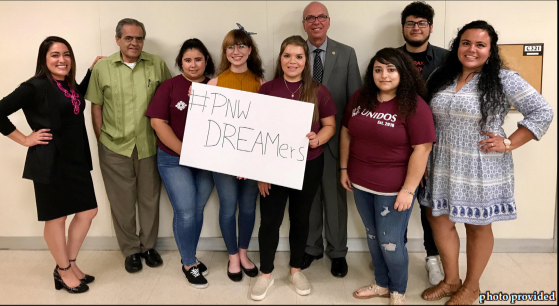 Members of Social Work Club and Unidos pose for a picture with Chancellor Thomas L. Keon (center), Jose Bustos (next to left) and Mayra Rodriguez (left) who also spoke at the event.