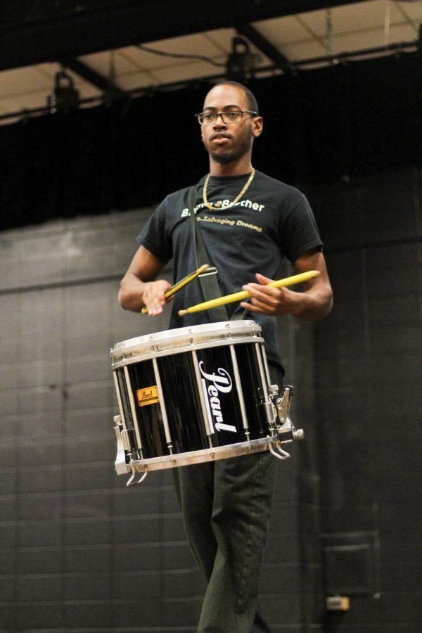 Dwayne+Hunter%2C+junior+business+entrepreneurship+major%2C+demonstrates+talent+with+his+drums.