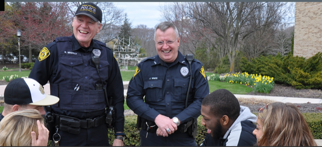 Campus+police+officers+Robert+Segally+%28left%29+and+Jeffery+White+%28right%29+speak+with+students+at+the+Westville+campus.