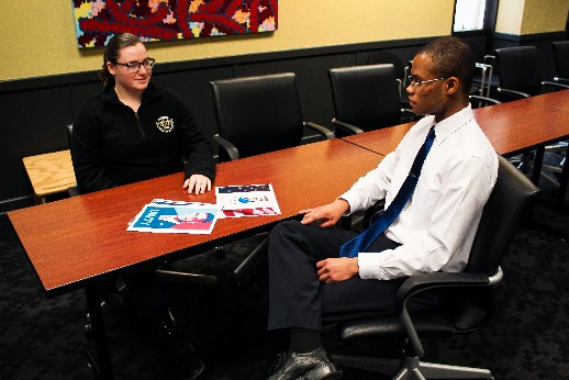 Victoria Von Uhl (left), junior communication major, discusses campaign strategy with Eric Taylor (right), junior finance, accounting and business analytics major.