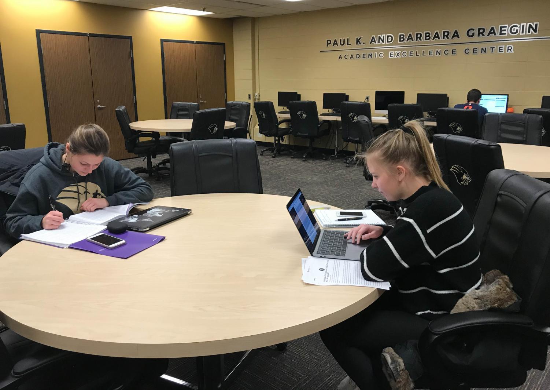 Anna Wachowski (left), freshman physiology major and tennis player, studies alongside teammate Lena Van Bergen (right), freshman business analytics major.
