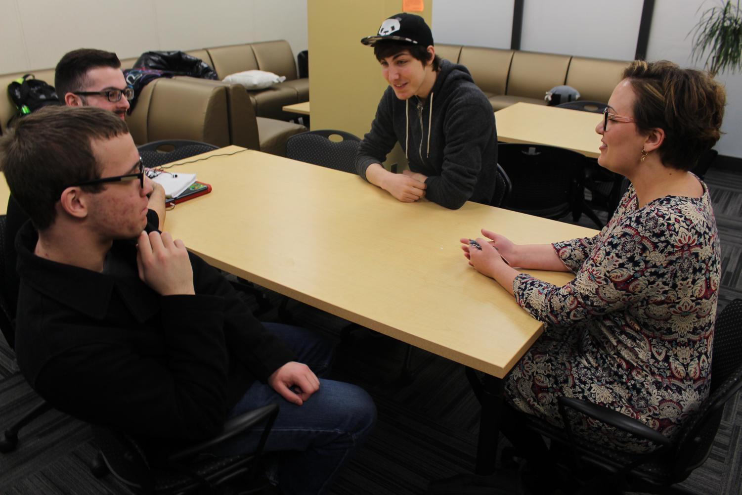 Natalie Beckley (right) introduces herself to Joshua Copeland, sophomore computer engineering major; Liam Ahearn, sophomore mathematics major; and Jacob Widowfield, freshman computer science major (left to right).