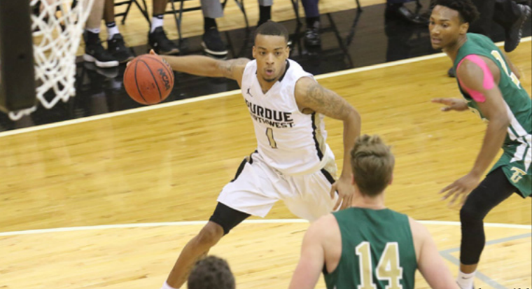Tyree+Coe%2C+senior+guard%2C+defends+against+players+from+Tiffin+University+during+their+Feb.+15+game.