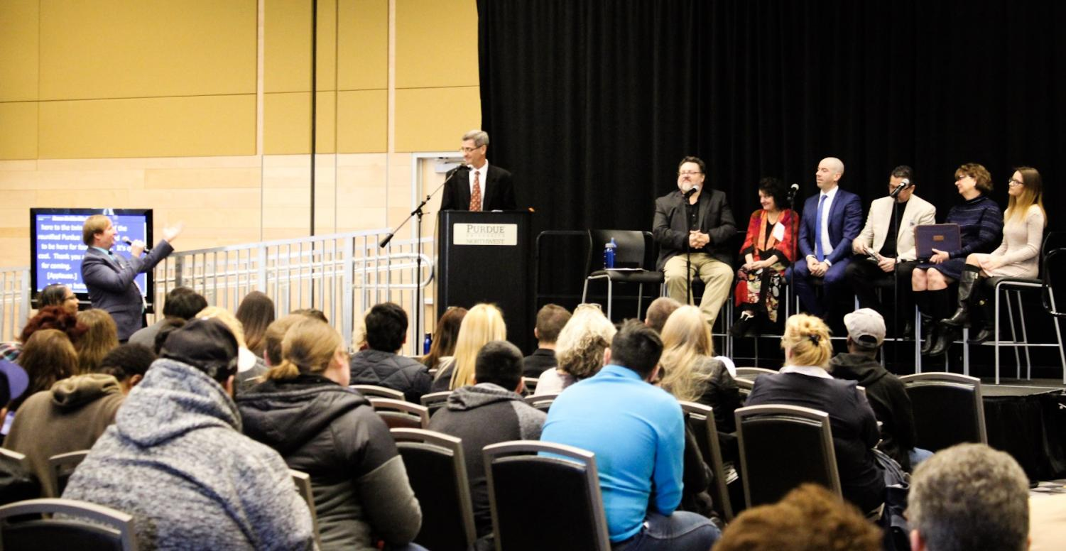 """Dan Wilbur, vice chair of Faculty Senate, asks a question to Edward Humes, Pulitzer Prize-winning author of """"Garbology,"""" during the One Book, One University event on March 2."""