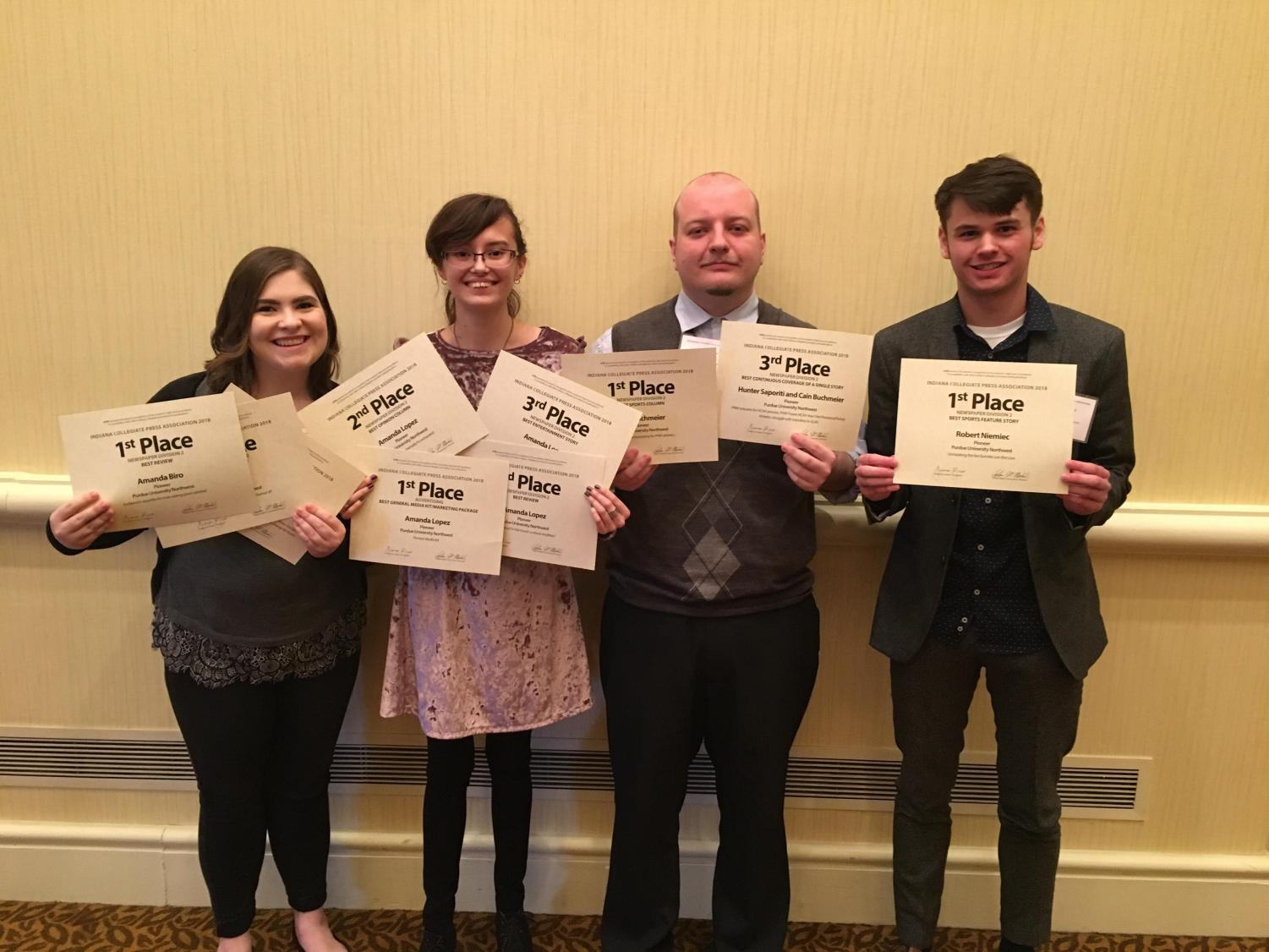Amanda Biro, news editor; Amanda Lopez, editor-in-chief; Cain Buchmeier, copy editor, and Robert Niemiec, staff writer, (left to right) attend the April 7 Indiana Collegiate Press Association 2018 convention.