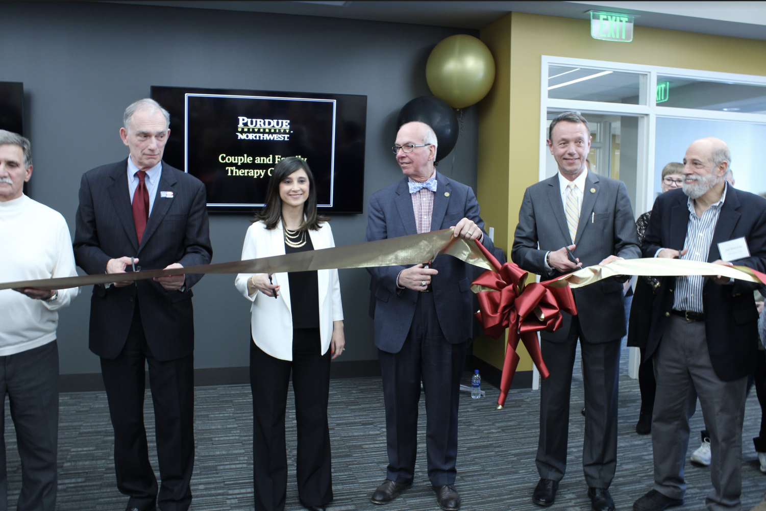 U. S. Rep. Pete Visclosky, Z. Seda Gulvas, interim director of the Couple and Family Center, Chancellor Thomas Keon and Provost Ralph Mueller cut the ribbon at the opening ceremony.