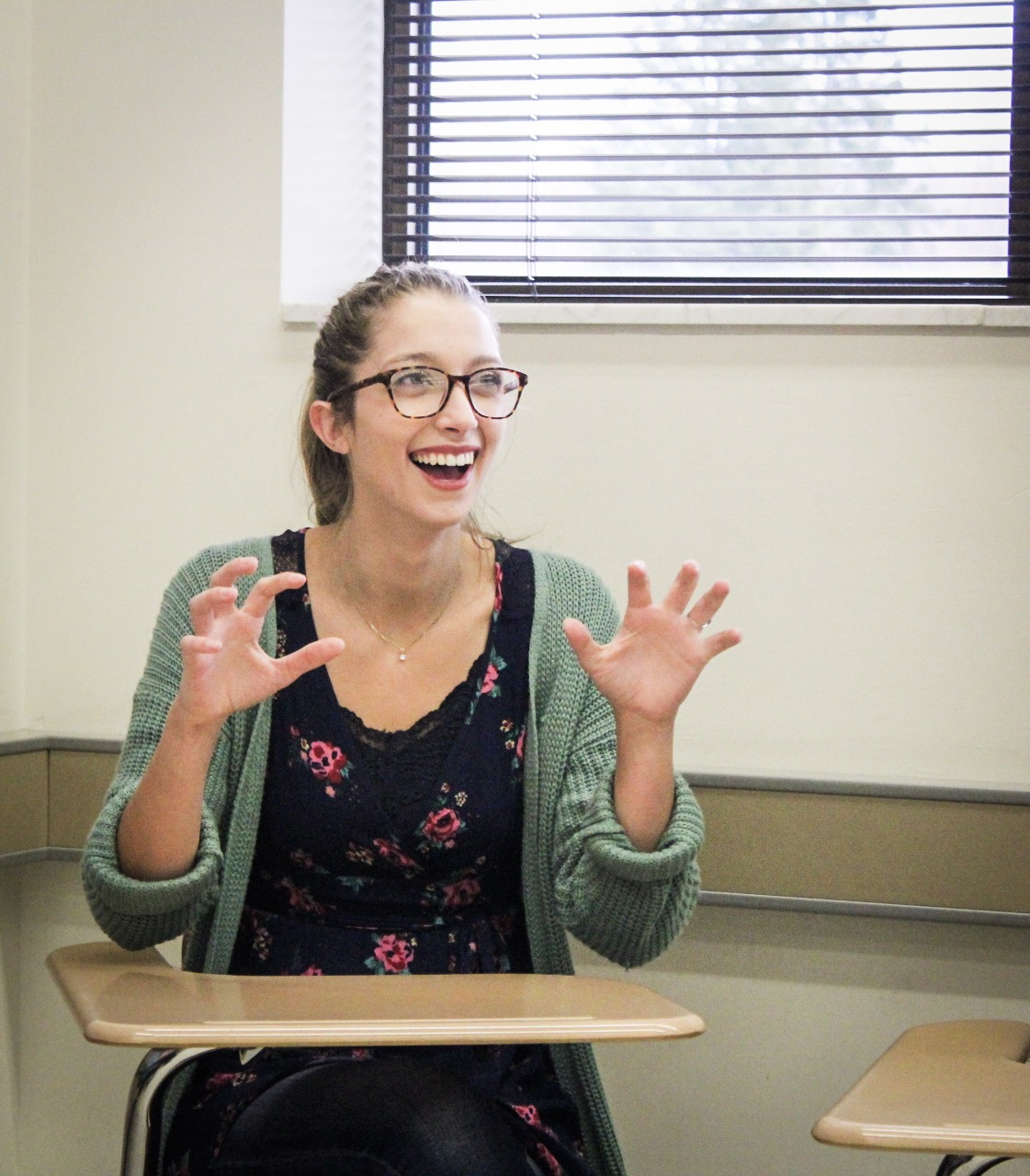 Hannah G. Scheffer, junior communication major, learns sign language.
