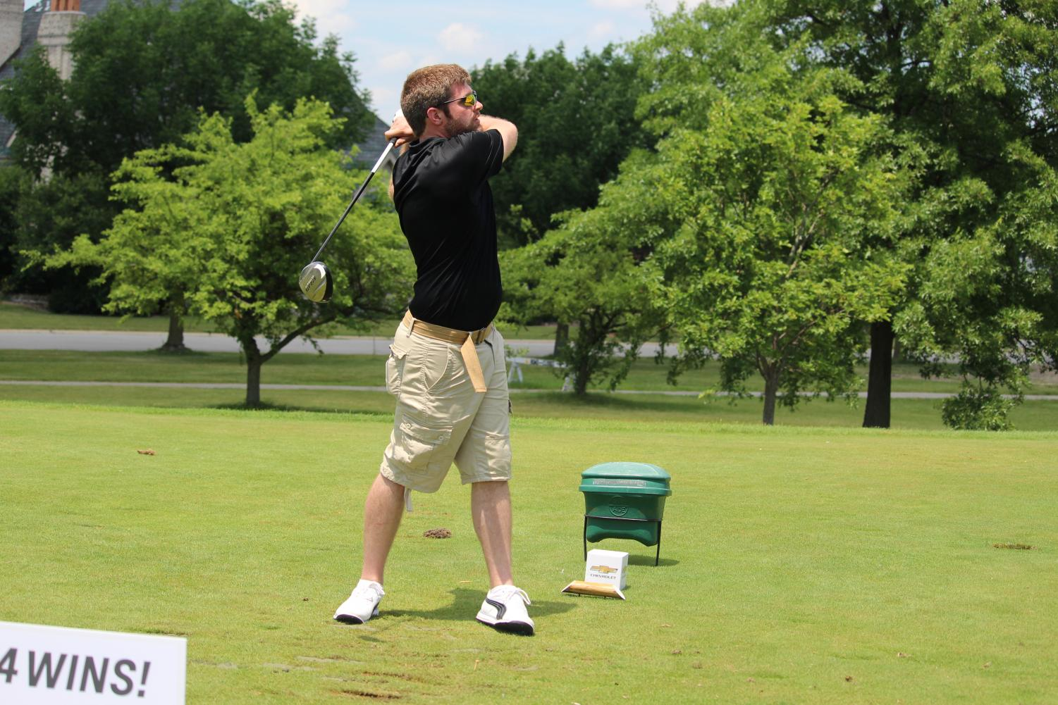 Michael Peterson, PNW information systems programmer, takes a swing at the outing.