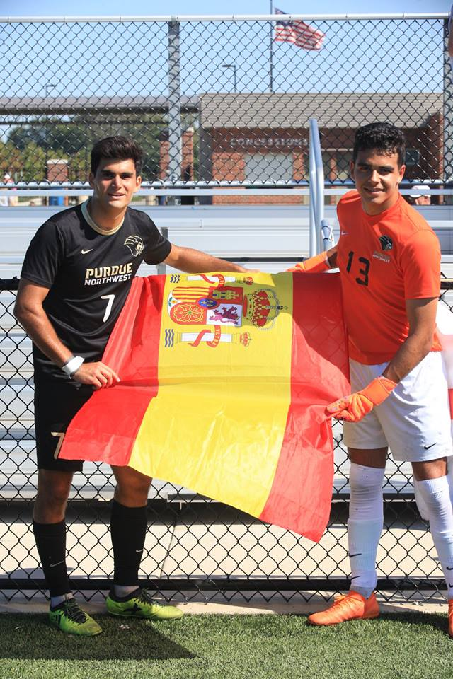 Enrique Serna, forward, and Raul Garrido Garcia, freshman goalkeeper, represent their home country before a game.