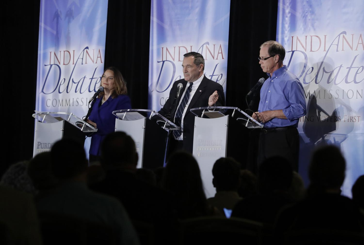 The three candidates running against each other debate topics of public interest on Oct. 8.