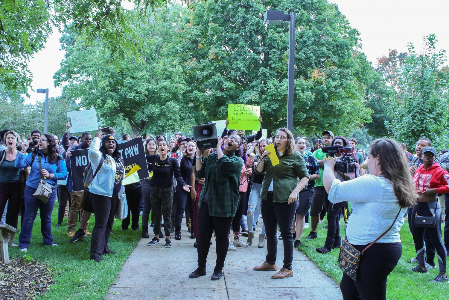 Students protested outside the university administration offices on both campuses on Oct. 1 to show their disagreement with the proposed diploma changes.