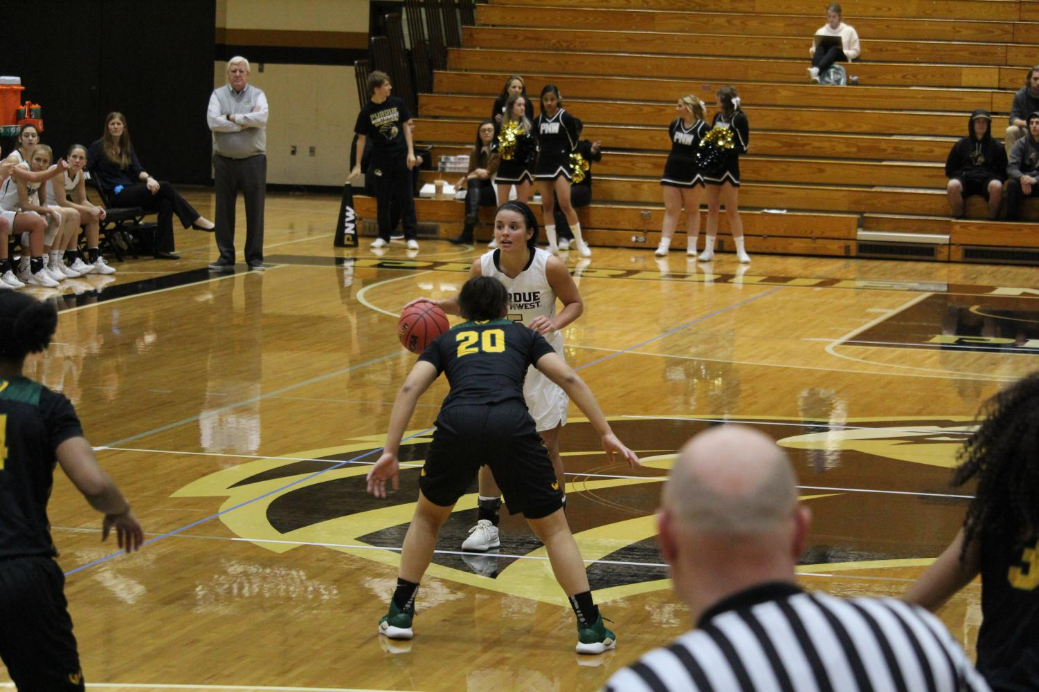Tayler Vauters, sophomore guard, looks for an opening around India Hawkins, senior guard for Wayne state, in the home game on Jan. 20.