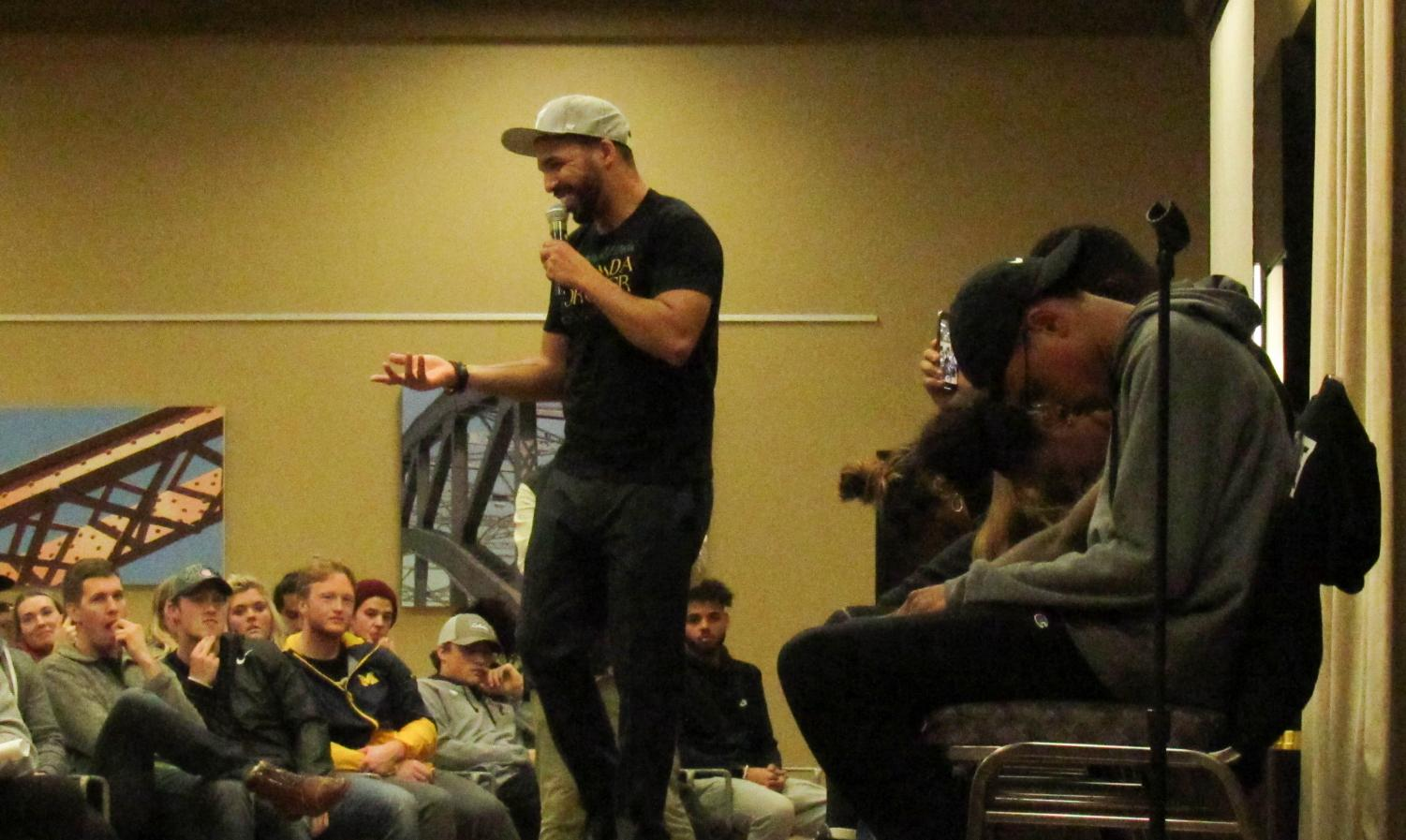 Chris Jones, hypnotist, takes student volunteers from the audience for his act.