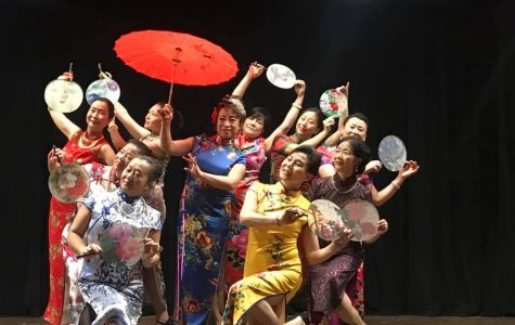 A dance team performs a Chinese traditional dress dance to celebrate the spring festival.