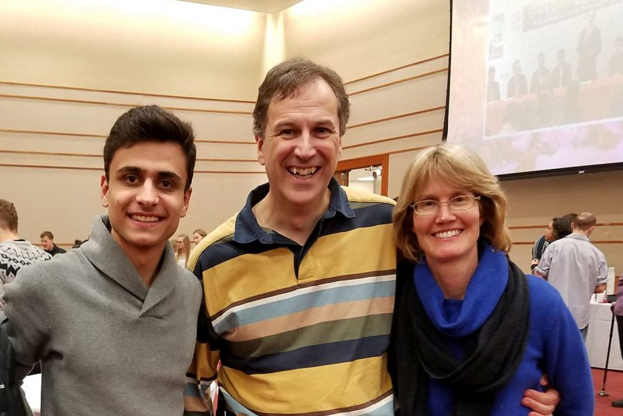 Abdullah Al-Abdal shares a moment with Tom and Amy Berube, who have hosted the PNW student at their Valparaiso home for three years.  Al-Abdal is the latest of 14 students the Berubes have hosted during the last eight years.