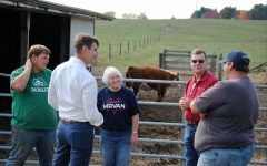 Democratic nominee Frank Mrvan (second from left) talks with voters about issues concerning the agriculture industry.